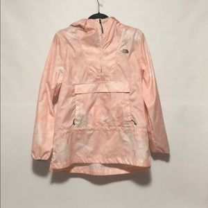 A pink and white North Face Windwall rain coat.